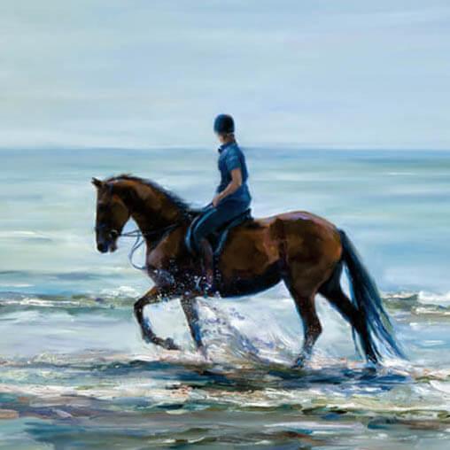 horseback riding on a beachfront calm waters
