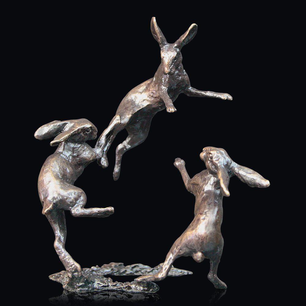 Three dancing hares